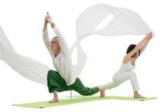 Man and woman doing yoga exercises in studio Stock Photo