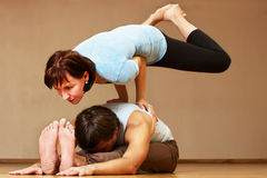 Man and woman doing yoga practice Stock Photography