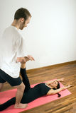Man and Woman Doing Yoga - Vertical Royalty Free Stock Photos