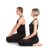 Man and woman doing yoga Royalty Free Stock Photos
