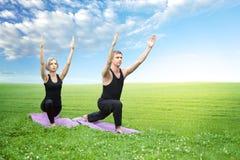 Man and woman doing yoga Stock Photography