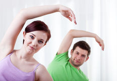 Man and woman doing yoga Royalty Free Stock Photography