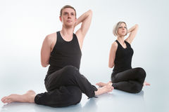 Man and woman doing yoga Stock Image