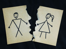 Man and woman drawing torn apart. On black background stock photo