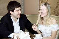 The man and the woman drink. Vine and coffee at restaurant Stock Photography