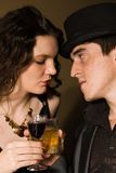 Man and woman drink alcohol in retro bar Stock Image