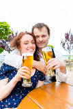 Man and woman drinking in beer garden pub Royalty Free Stock Photography