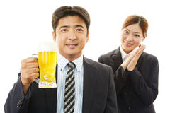Man and woman drinking beer Stock Image