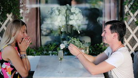 Man and woman drinking champagne in a cafe. stock footage