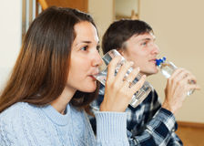 Man and  woman drinking clean water Royalty Free Stock Images