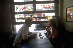 Man and woman drinking coffee in Caf� Couple and Cappuccino as she smokes cigarette in Buenos Aires, Argentina Stock Photos
