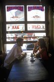 Man and woman drinking coffee in Caf� Couple and Cappuccino in Buenos Aires, Argentina Stock Image