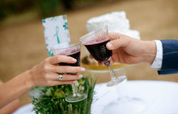 Man and woman drinking red wine. close-up hands with glasses. Stock Image
