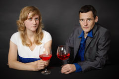 Man and woman drinking red wine at table Stock Photo