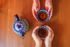 Man and woman drinking tea in Samarkand, Uzbekistan. Oriental cuisine. Stock Images