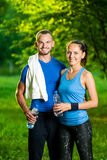 Man and woman drinking water from bottle after Royalty Free Stock Image