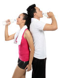 Man and woman drinking water after fitness Royalty Free Stock Image