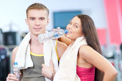 Man and woman drinking water after sports Royalty Free Stock Photo