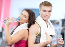 Man and woman drinking water after sports Stock Image