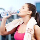 Man and woman drinking water after sports Stock Photography