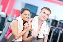Man and woman drinking water after sports Royalty Free Stock Photos