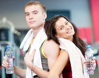 Man and woman drinking water after sports Stock Photo
