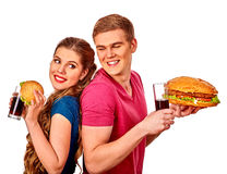 Man and woman eating big sandwich with cola Stock Photo
