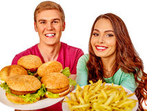 Man and woman eating big sandwich with cola.  . Royalty Free Stock Images