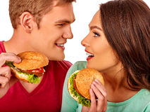 Man and woman eating big sandwich with cola Stock Photography