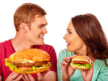 Man and woman eating big sandwich with cola Royalty Free Stock Photos