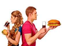 Man and woman eating big sandwich with cola Royalty Free Stock Photo