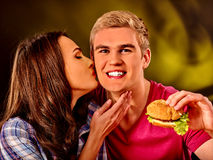 Man and woman eating big sandwich Stock Image