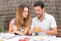 Man and woman eating in garden. Happy couple having food in garden Stock Images