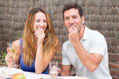 Man and woman eating in garden. Happy couple having food in garden Stock Photography