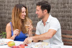 Man and woman eating in garden. Happy couple having food in garden Stock Photos