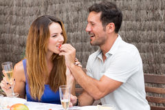 Man and woman eating in garden. Happy couple having food in garden Royalty Free Stock Images