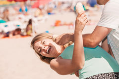 Man and woman eating ice cream on beach Royalty Free Stock Images