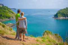 Man and woman embraces on tropical island cliff Stock Photography