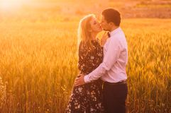 Man and woman embracing in poppy field on the dusk. Man and women embracing in poppy field on the dusk, countryside Malta stock images