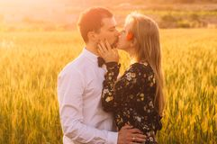 Man and woman embracing in poppy field on the dusk. Man and women embracing in poppy field on the dusk, countryside Malta stock photos