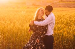 Man and woman embracing in wheat field on the dusk. Man and women embracing in wheat field on the dusk, countryside Malta royalty free stock images