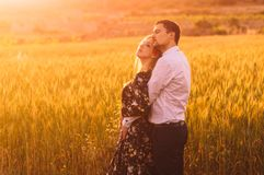 Man and woman embracing in poppy field on the dusk. Man and women embracing in poppy field on the dusk, countryside Malta stock image