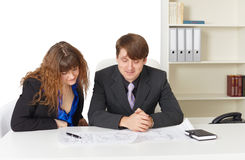 Man and woman - engineers, working in office Stock Images