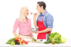 Man and woman enjoy cooking together Stock Photos