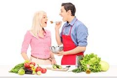 Man and woman enjoy cooking together Stock Photos