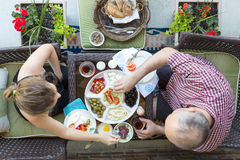 Man and woman enjoy an outdoor Turkish breakfast Royalty Free Stock Image
