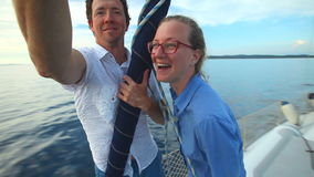 Man and woman enjoying sailboat trip on adriatic in Croatia stock video