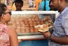 Man and a woman enjoying Street food Stock Photo