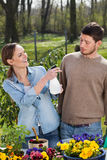 Man and woman enjoying sunny day in garden Royalty Free Stock Images