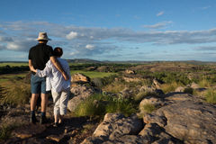 Man and woman enjoying view. Man and women enjoying view with arm round each other at Ubirr, Kakadu Stock Photography